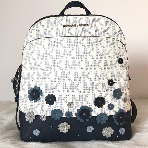 2398fc3e4d5d Michael Kors Navy Blue Floral Backpack. M_5c634cb41b329485d1ba10e7